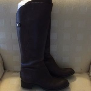 Knee high leather boots with zipper back